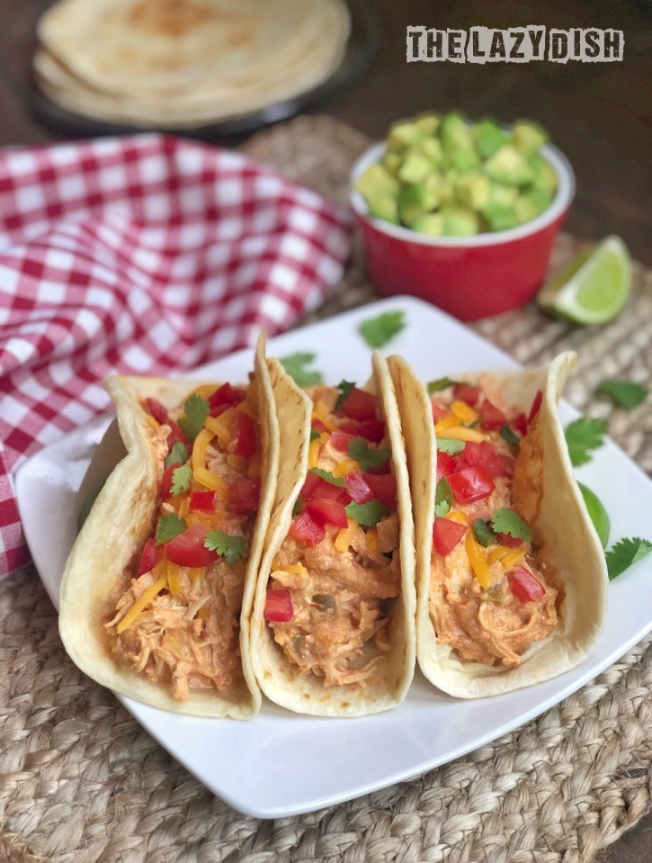 Quick and easy dinner idea! Crockpot shredded chicken tacos made with 3 ingredients!