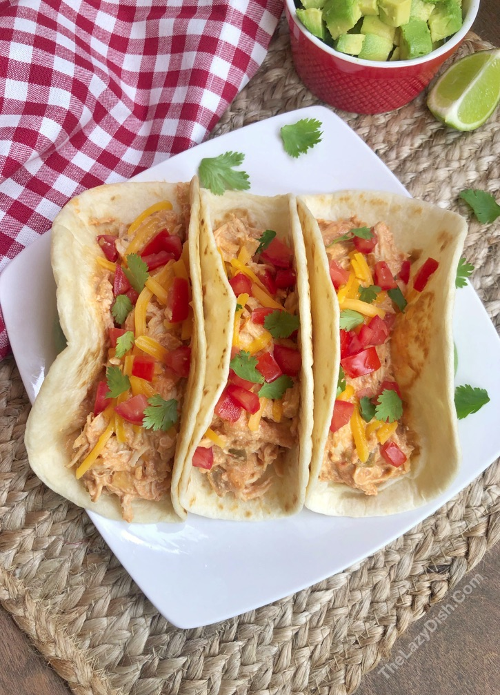 Easy Crockpot Chicken Recipe - Creamy Chicken Tacos made with 3 ingredients: chicken, salsa and cream cheese!