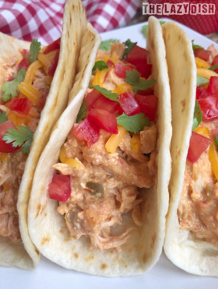 3 Ingredient Crockpot Shredded Chicken Tacos Recipe - quick and easy dinner idea for the family! The Lazy Dish